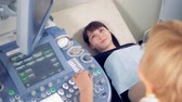 sonography : Pregnant woman is undergoing an ultrasonic session