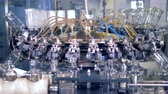 washing up : Bottle washing machine, close up. Factory machine washes bottles with water. Stock Footage