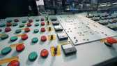 recycling facility : Many buttons on a console desk, close up. Stock Footage