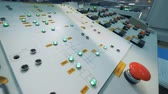 recycling plant : Buttons and lights on a industrial dashboard with monitors, close up. Stock Footage