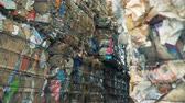 karton : Many stacks of compressed cardboard, close up. Stok Video