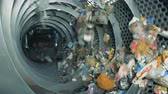 unclean : Factory equipment rotates garbage to sort it. 4K.