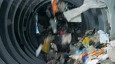 recycling facility : Garbage ready for recycling in a garbage sorting center. Stock Footage