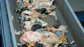 recycling facility : Discarded trash on a factory conveyor, close up.