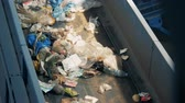 recyclable : Recycling factory with conveyors. Sorting garbage equipment working at a recycling plant. Stock Footage