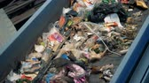 recyclable : Recyclable garbage on a line. Sorting garbage equipment working at a recycling plant. Stock Footage