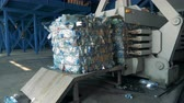 мусор : Special machine for pressing garbage. Factory equipment compresses bottles for recycling at a dump.