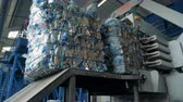 縛ら : Process of garbage pressing, close up. Big machine prepares plastic bottles for recycling at a plant.