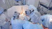 tweezers : Many people in a surgery room, top view. Stock Footage