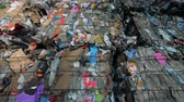 縛ら : Pressed garbage at a recycling factory, close up.