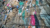 recyclable : Long stacks of garbage, close up. Pressed plastic trash is at a recycling factory. Stock Footage