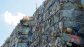 rozdrtit : Household garbage in stacks, close up. Pressed trash is ready for recycling at a factory.
