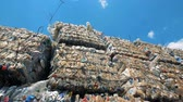 곤포 : Mass of trash on a landfill. Many piles of garbage is on a dump, ready for recycling. 무비클립