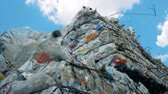 recyclable : Tied piles of recyclable trash. Garbage is on a landfill, tied with metal wire.