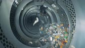 unclean : Lots of garbage rotates at a factory. Sorting process of household trash. Stock Footage