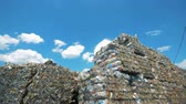 recycling facility : Packed rubbish on a sky background, close up.