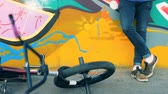 grafiti : BMX bike falls on the ground in a skatepark. 4K.