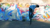 grafiti : Man doing tricks on a BMX. Young stylish teenager in active lifestyle.