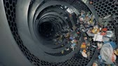 recycling facility : Lots of trash in a recycling center. Recyclable garbage rotates in a special machine at a plant.