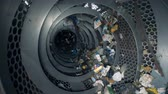 utilization : Process of garbage separation at a factory, slow motion.