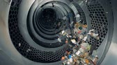recycling facility : Special equipment sorts garbage at a plant, slow motion.