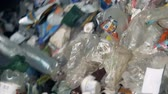 utilization : Plastic and paper trash sorting at a factory, close up.