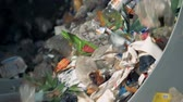 utilization : Lots of waste at a recycling center, close up.