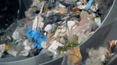 сортировать : Lots of household trash is sorted for recycling at a plant. 4K.