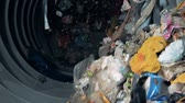 сортировать : Big equipment sorts trash. Household garbage moves in a special machine to be sorted.