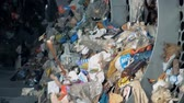 utilization : Trash sorting for recycling and disposing. Plastic garbage rotates in a machine at a factory while sorting.