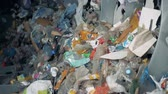 сортировать : Household garbage at a factory for waste disposing. Process of trash sorting in a special machine at a plant.