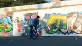 grafiti : Urban ground with a young man riding a BMX