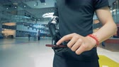 sintético : A man is holding a smartphone in his futuristic bionic prosthetic hand. Man of future concept.
