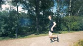 strengthen : Jogging training of a young man with a robotic bionic arm Stock Footage