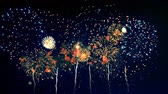 четверть : Colourful fireworks are getting displayed into the sky