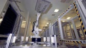 electronics industry : Robotic arm at factory.