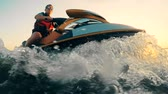 моторная лодка : A waverunner is being driven in the waters by a male professional