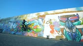 grafiti : One rider jumping on a wall, pigeon runs away. Dostupné videozáznamy