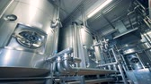 cervejaria : Many pipelines, metal tanks, containers in a factory room. 4K.