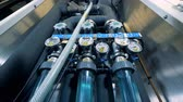 purified : Modern water purification equipment. Valves, gauges at a water quality control panel.
