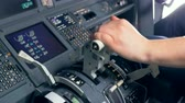 A man uses a helm in a flight simulator, close up. Stock Footage