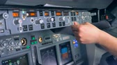 compass : View of monitors on a plane, close up.