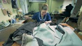 Tailor sewing animal skins together, close up. Stock Footage