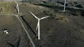 inventário : Alternative energy concept. Top view of a natural terrain with several windmill constructions Stock Footage