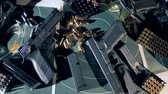 atirador : Guns, weapons with bullets on a shooting range, top view. Stock Footage