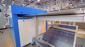 ремень : Solar panel is moving along the conveyor belt and reflecting in a mirror