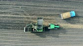 potato harvest : An empty tractor standing on a field, top view.