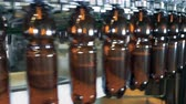 ремень : Beer bottles filled at a brewery, close up.