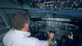 кокпит : People practicing in a flight simulator, close up.