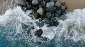 dinginlik : Sea water with foam is washing the coastline and rocks on it